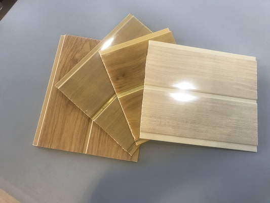 China Lightweight 8 Inch Pvc Wall Cladding With Wooden Groove For False Ceiling supplier